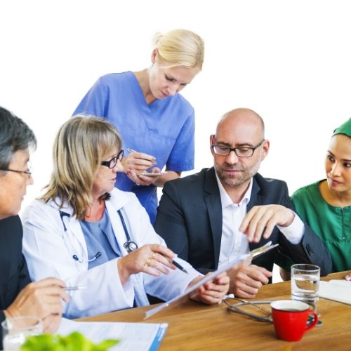 image of a doctor discussing with his patients and nurse taking notes