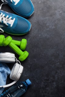 image from above of running shoes, mat, headphones, water bottle