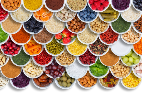 picture of colorful foods in small bols making a pretty shape