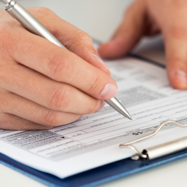 closeup of someone filling out a form