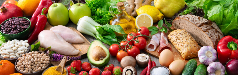 Table full of fruits, vegetables, grains, meat